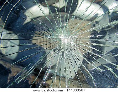 Broken glass in a old rusty car
