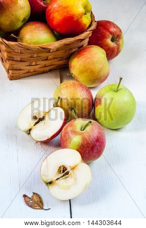 Autumn apples on a white wooden table