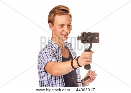Man Holds Small Action Camera On Gimbal.