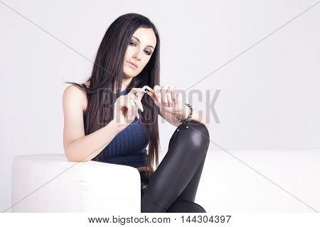 Young Brunette Woman Thinking About Quit Smoking.