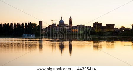 Europe Italy Mantova-Mantua ancient castle at the river reflecting in still waters at sunset highly illuminated by lights