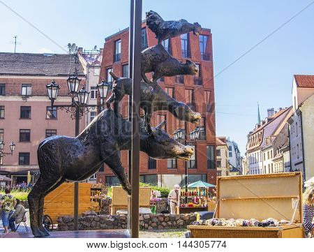 background  Bremen musicians famous monument in the square at the Church of St. Peter in Riga