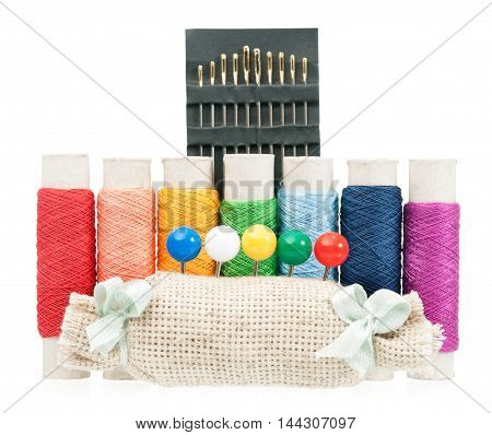 Rainbow made of color threads with needles isolated on white background