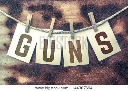 Guns Concept Pinned Stamped Cards On Twine Theme