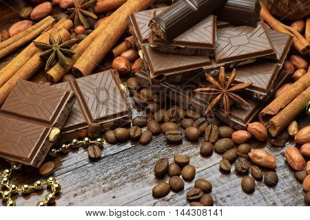 Chocolate cinnamon coffee peanuts star anise. Christmas mood. Festive flavors. Sweet Dream. Close-up. / Selective Focus /