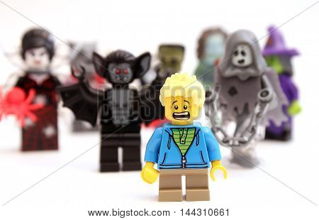 Colorado, USA - August 26, 2016: Studio shot of LEGO minifigure boy frightened by scary creatures.