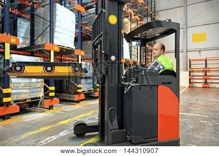 Forklift With Shuttle Pallet in Distribution Warehouse