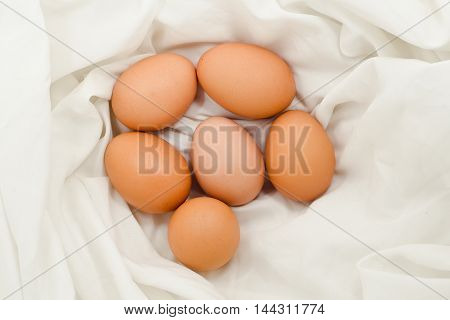 Eggs On Fabric White.chicken Eggs On White Fabric.easter Eggs On Fabric With Copy Space.
