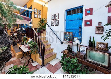 LOUTRO, CRETE, GREECE - JULY 2016: Vintage interior of traditional Greek house at Loutro town on Crete island.