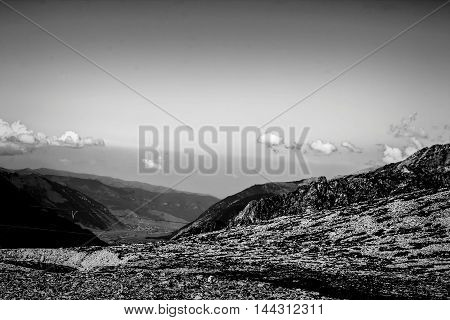 it is black a white landscape, the mountain valley