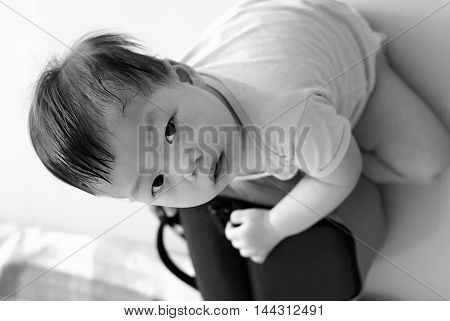 Cute Asian Baby in white dress playing in living room black & white style