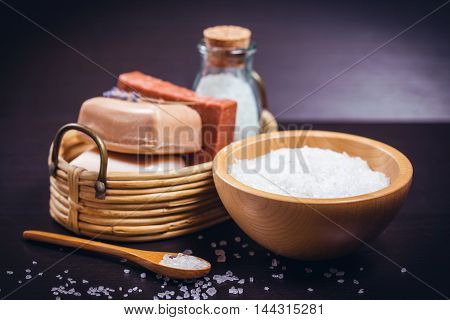 Spa and wellness setting with natural soap and sea salt.