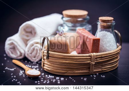 Spa and wellness setting with natural soap sea salt and towels.