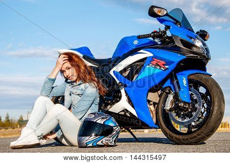 Pretty Young Woman And Suzuki Gsx-r750