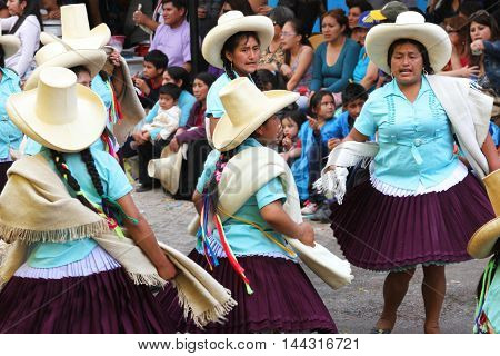 Cajamarca Peru - February 8 2016: Peruvian women in sombreros and traditional dresses dance in Carnival parade in Cajamarca Peru on February 8 2016