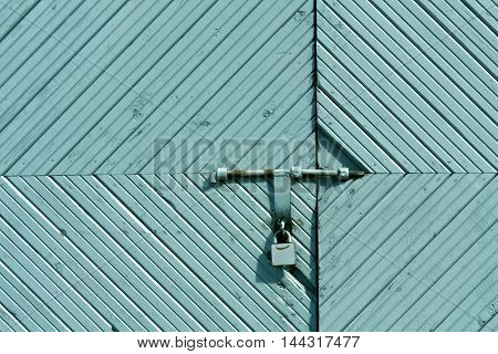 Old Wooden Gate With Metal Padlock.