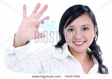 Happy Young Businesswoman Holding Jigsaw Puzzle