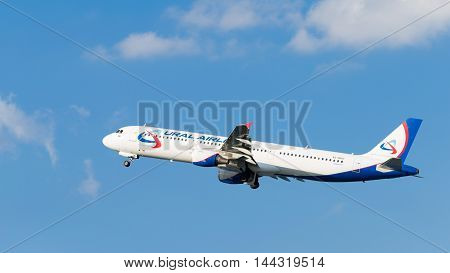 Moscow - July 31 2016: Airbus A321-211 passenger aircraft Ural Airlines flies to Domodedovo airport and on a background of blue sky July 31 2016 Moscow Russia