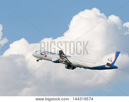 Moscow - 31 July 2016: large passenger aircraft Airbus A321-211 Ural Airlines flies to Domodedovo airport and on a background of blue sky July 31 2016 Moscow Russia
