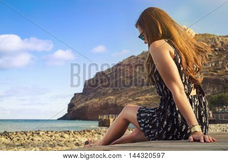 young tourist girl on the beach of madeira