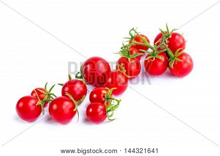Cluster of small tomatoes on white background