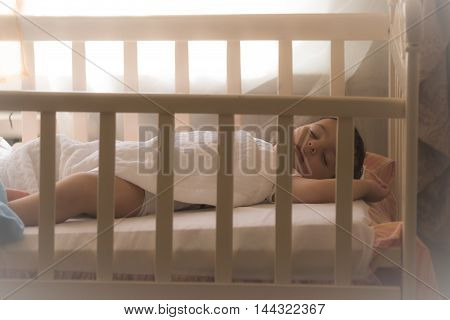 Sleep tight little one. Baby in a crib