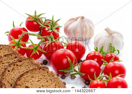 Composition of black bread tomatoes and garlic