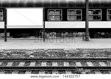 Empty railway station with track and place for promotion. Black and white.