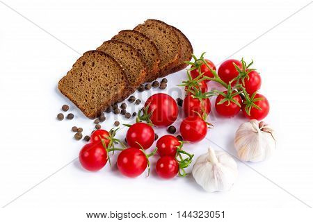 Composition of black bread cherry tomatoes and garlic