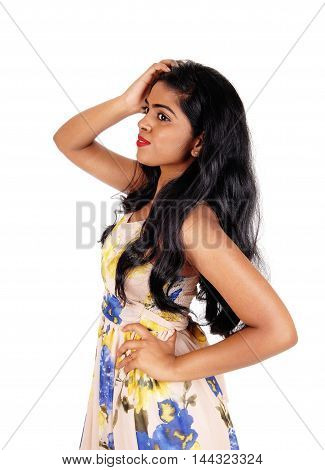 A beautiful young Indian woman standing in profile with her long black hair waist up isolated for white background.
