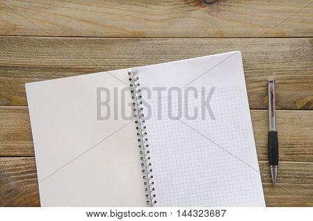 White paper with pen for text on a table