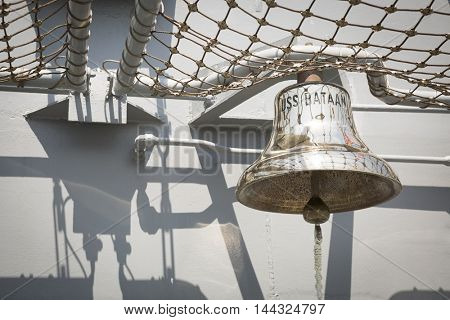 NEW YORK MAY 26 2016: The brass bell of the USS Bataan (LDH 5) an amphibious assault ship moored at Pier 88 for Fleet Week NY 2016.