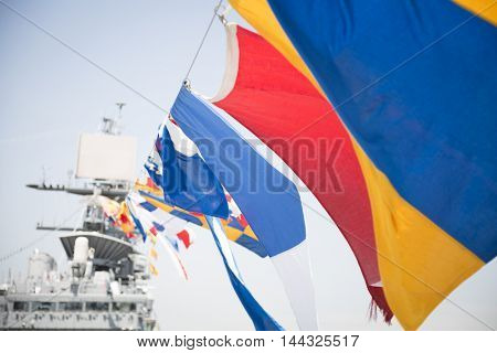 NEW YORK MAY 26 2016: Ornamnetal signal flags on the flight deck of the USS Bataan (LDH 5) an amphibious assault ship moored at Pier 88 for Fleet Week NY 2016.