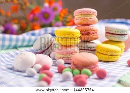 Sweet still life with macaroon cookies and marshmallow