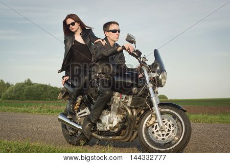 Active Couple Riding On The Motorbike
