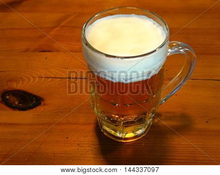 A mug of beer on the table drink alcohol recreation relaxation degree draft taste bar club