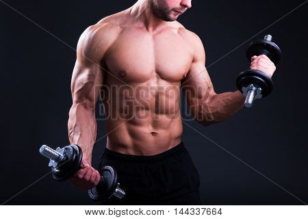 Muscular Body Of Young Man Posing With Dumbbells Over Grey
