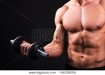 Close Up Of Muscular Man Doing Exercises With Dumbbell Over Grey