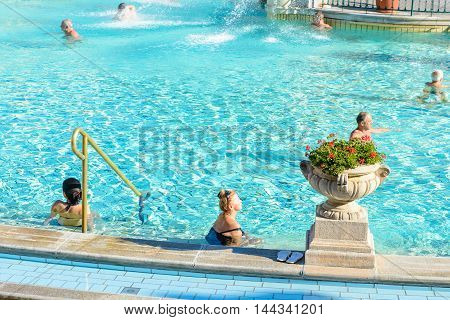 BUDAPEST, HUNGARY - AUG 18, 2014: Unidentified people in a  Pool of the Szechenyi Medicinal Bath complex , the largest medicinal bath in Europe, built in 1913