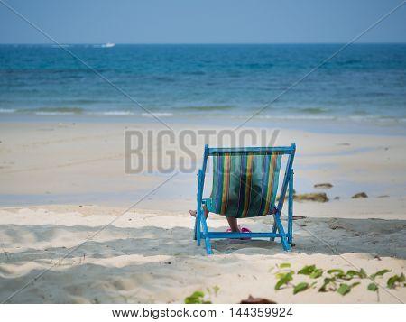 Kid Sitting On Beach Chair