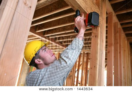 Construction Man Using Drill
