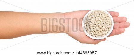 hand with beans isolated on white background