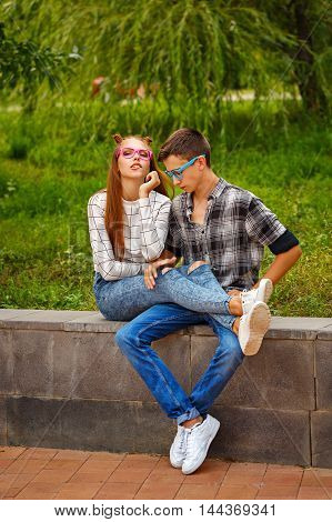 Loving couple teens. Girlfriend and boyfriend together. They wear glasses. First love. He falls in love. Date.