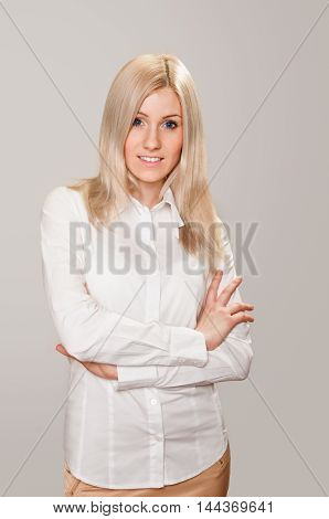 portrait of beautiful blonde young woman with nice look. On white
