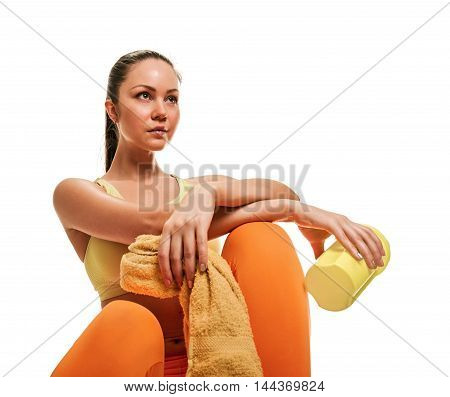 Fitness woman with bottle of water and towel on white background.