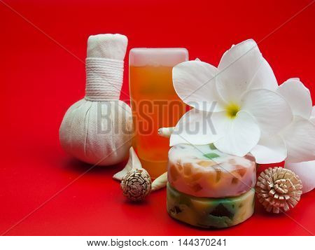 Beautiful composition of spa treatment On a red background.