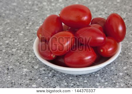 a bowl full of small red grape tomatoes grape tomatoes