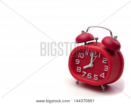 red style alarm clock Put on a white background.