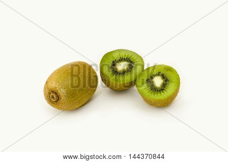 Whole and cut Kiwi fruits on a white background