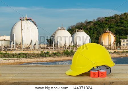 Lpg Gas Storage Sphere Tanks And Yellow Safety Helmet With Blue Sky Background In Thailand